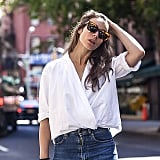 Blogger Irina Lakicevic rocked this twisted white top during New York Fashion Week, proving that even the most basic of basics can become fashion forward with some great styling.