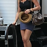 Jennifer brought her Stuart Weitzman crochet Alex wedges to the set of her movie once again. This time she paired them with a blue striped bandage skirt and a black tank.