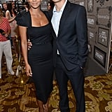 Halle Berry and Olivier Martinez kept their arms around each other inside.