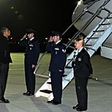 Obama blew kisses as Michelle boarded her flight.