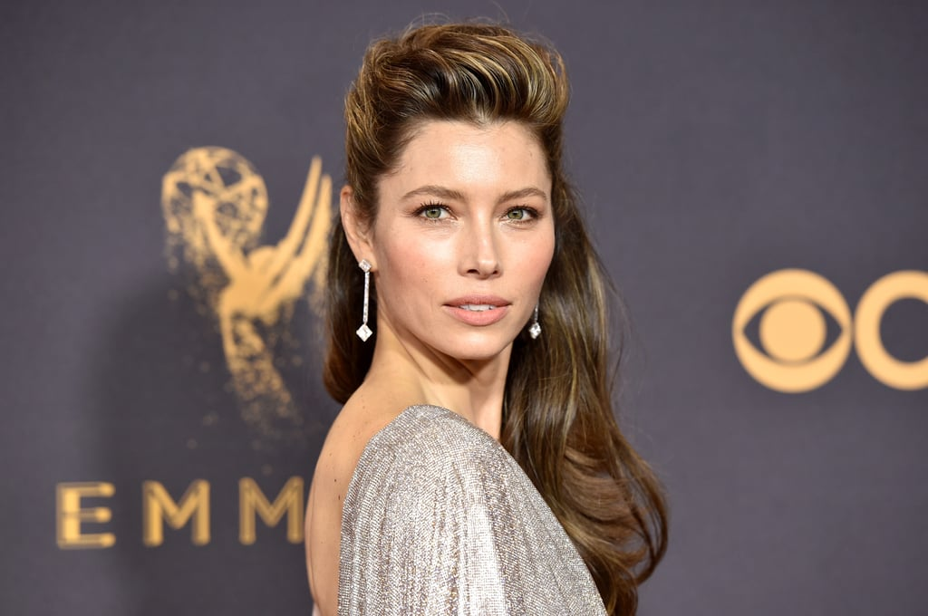 Jessica Biel went for a bold and beautiful look at the 2017 Emmy Awards. The 35-year-old actress made a statement with her sexy pompadour hairdo, which complemented her backless silver and beige gown for the evening.  Her voluptuous hair was the real star of the show. Jessica's hairstylist, Adir Abergel, teased the slicked back up-do on Instagram before she walked the red carpet. The actress's brunette mane was highlighted with blonde streaks, which made her heightened hair stand out even more.   As for makeup, Jessica's makeup artist, Kara Yoshimoto Bua, kept things simple, applying a nude lip and tan-coloured eye shadow, allowing her big hair to receive all of the attention it deserved. Keep reading to see all angles of Jessica's beauty look at the Emmys!