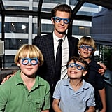 He posed in silly glasses with a group of kids at an NYC charity event in June 2012.