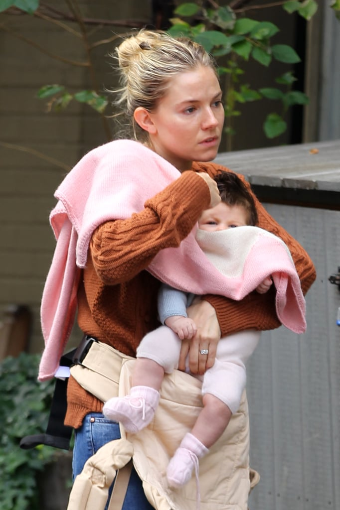 Sienna Miller carried Marlowe in her arms as they left a café in NYC yesterday morning. The mother-daughter duo travelled to the Big Apple with Sienna's fiancé and Marlowe's dad, Tom Sturridge, last week. Sienna's been promoting her HBO project, The Girl, but has fit in plenty of family time when she's not working. Over the weekend, Sienna and Marlowe explored Central Park, and on Monday, Tom and Sienna were spotted heading into their hotel together. That same day, Tom met up with pal Robert Pattinson, though Rob has since returned to LA and his reportedly on-again girlfriend, Kristen Stewart.