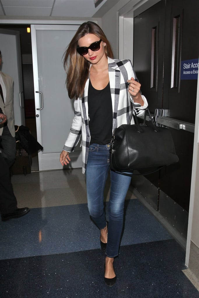 During her arrival to LAX airport, Miranda Kerr proved that plaid doesn't have to be preppy. Just pair your checkered blazer (hers is by Stella McCartney) with cropped skinny jeans, a black scooped tee, ballet flats, and a statement bag (Miranda's is Givenchy).