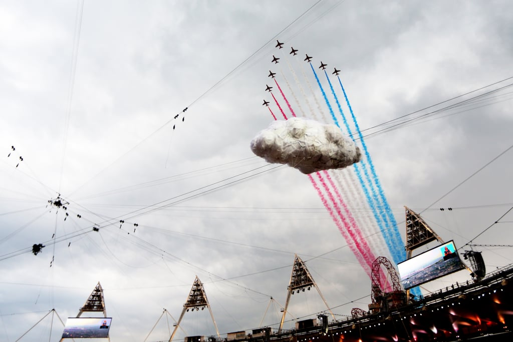 The Red Arrows, the Royal Air Force aerobatic team, flew over the stadium during the opening ceremony