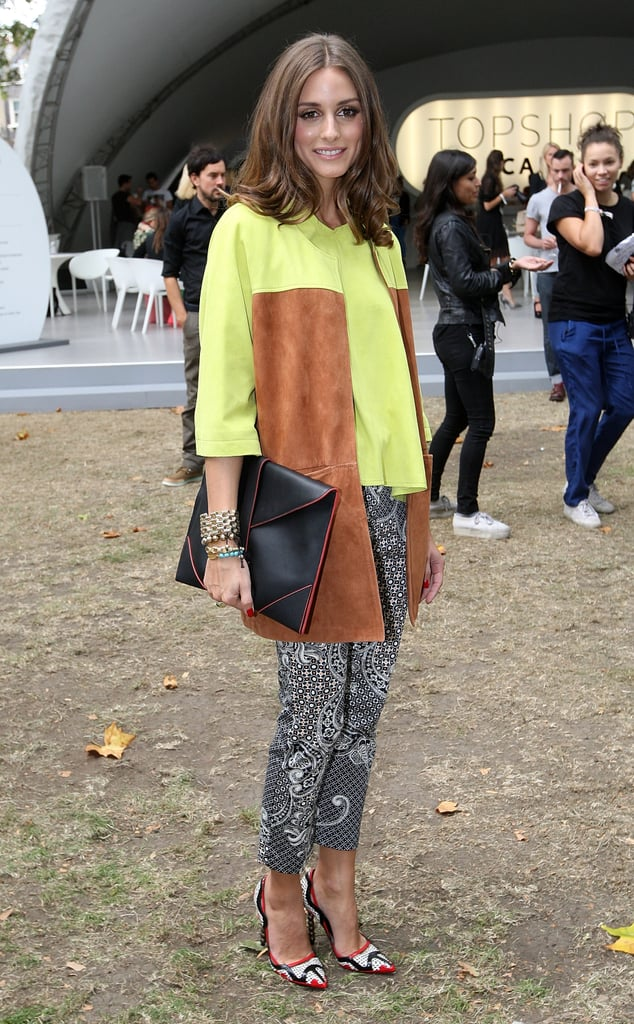 As only Olivia can, she mixed bold statement color, texture, and print on her Simonetta Ravizza top and Topshop pants with ease for the Topshop Unique show at LFW. 8761865