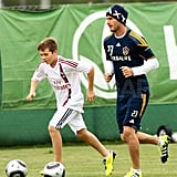 David and Brooklyn Beckham on the soccer field in LA.