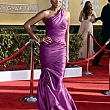 Mad Men's Teyonah Parris worked the red carpet in a violet satin one-shouldered confection with diamond chandelier earrings and a matching bracelet.