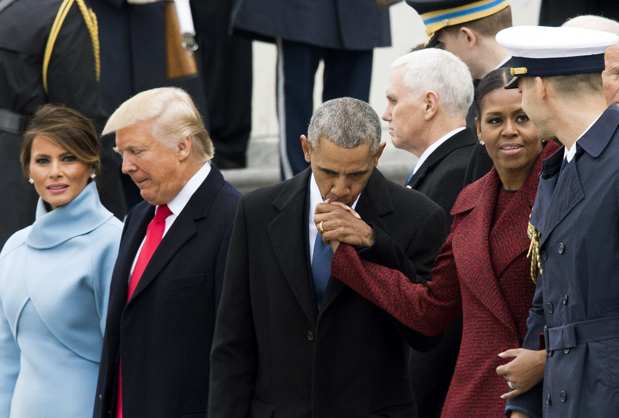 Inauguration photo of obamas and trumps next to each other still it represents how the trumps seem less comfortable in the spotlight while the obamas are known for their welcoming personalities and affection for m4hsunfo