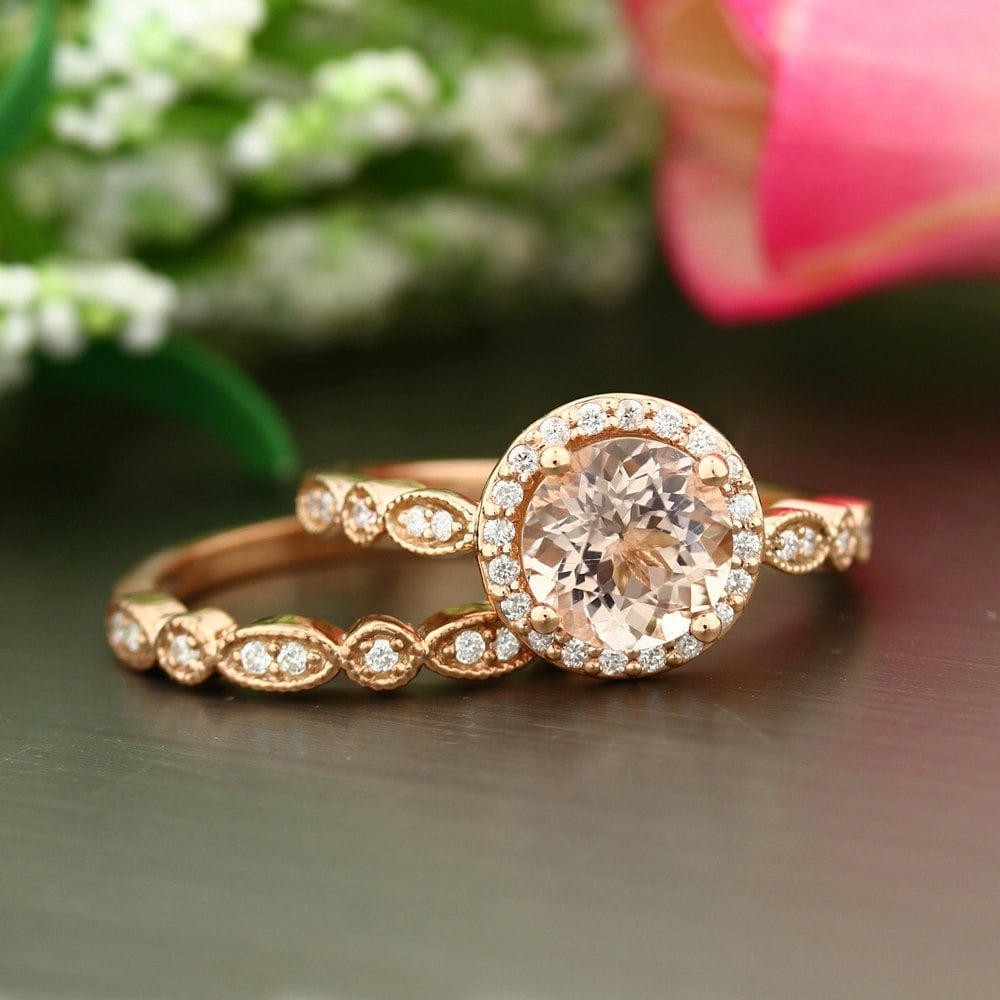 A ring doesn't get any more art deco than this 8 mm round-cut style ($1,538) surrounded by conflict-free diamonds.