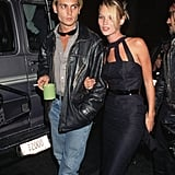 With Johnny Depp in 1995, wearing a halter dress with cutouts at the neck.
