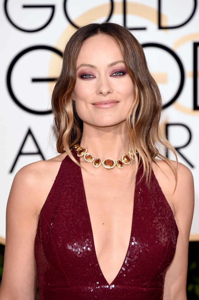Olivia completed her look with a jeweled choker necklace.