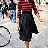 Shiona Turini made an entrance in bold stripes and a high-waist skirt.