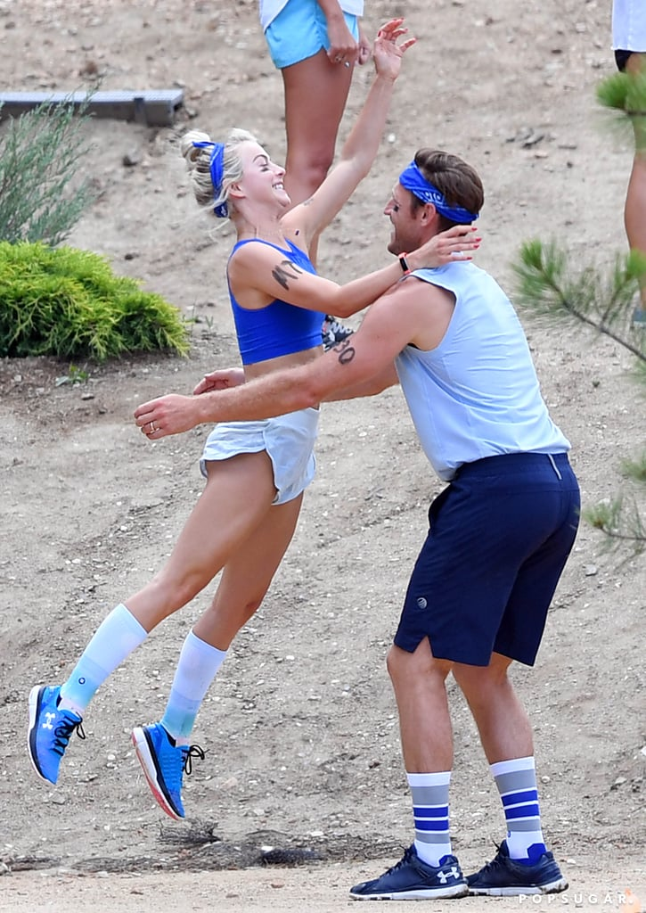 Julianne Hough and Brooks Laich are getting right back into action following their relaxing honeymoon last month. After hitting the beaches of Seychelles and taking a safari in Kenya, the newlyweds showed off their sporty sides as they celebrated their friend's birthday at Noon Lodge in Big Bear Lake, CA, on Sunday. While Brooks opted to go shirtless for a few of the events (it looked like a Summer camp-esque color war), Julianne flaunted her washboard abs in a blue sports bra and shorts. Aside from competing in a water-balloon-throwing contest and an egg relay race, the pair showed off their sweet chemistry as Julianne happily jumped into her husband's arms. Looks like Julianne really is a total catch. Get it?      Related:                                                                                                           The Story of How Julianne Hough Met Brooks Laich Will Make You Believe in Destiny