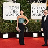Newly engaged Olivia Munn rocked an embellished dress on the Golden Globes red carpet.