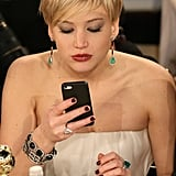 Jennifer Lawrence studied her phone, possibly playing Candy Crush. Source: Christopher Polk/NBC/NBCU Photo Bank/NBC