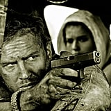 Hardy as Mad Max and Theron as Furiosa in the back.