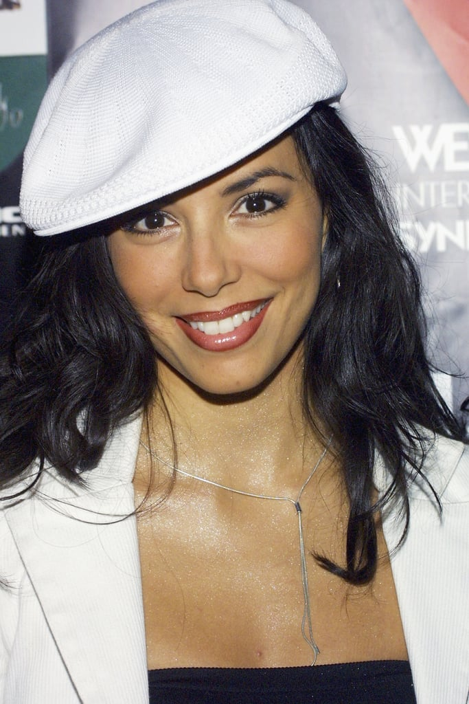 Eva worked the 2003 red carpet for her then-new TV show The Talent Agency in a white hat atop her tousled hair. She paired the look with visible lip liner and gray eye shadow.