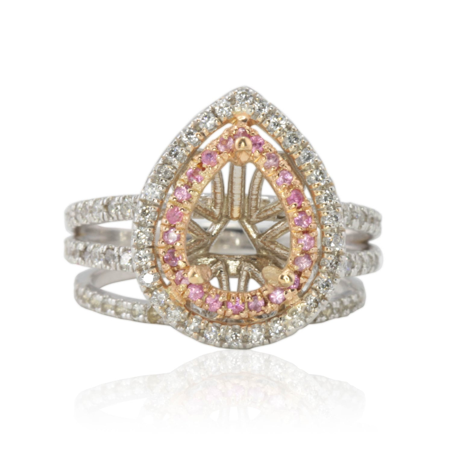 pink sapphire and pear shaped engagement ring