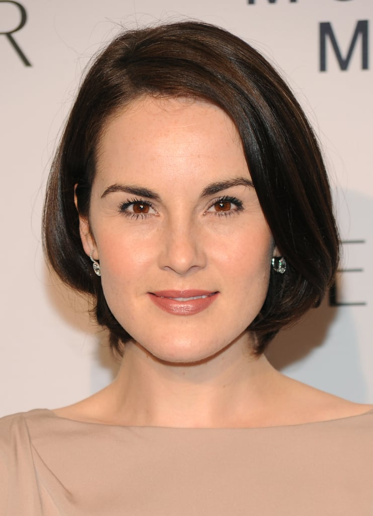 Michelle Dockery aces the straight hair trend, adding a touch of bounce to soften the style.