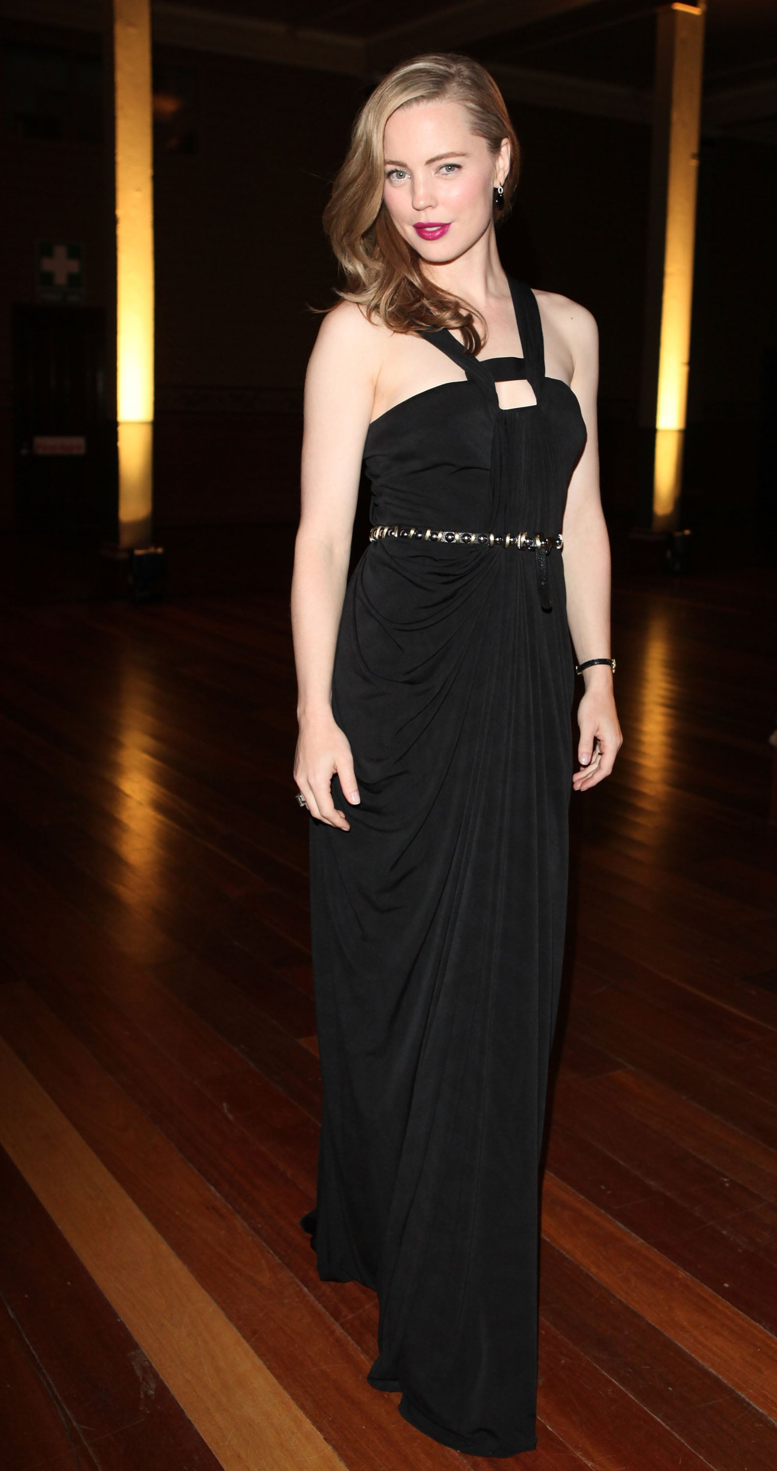 LMFF ambassador Melissa George looked chic in a long black dress.