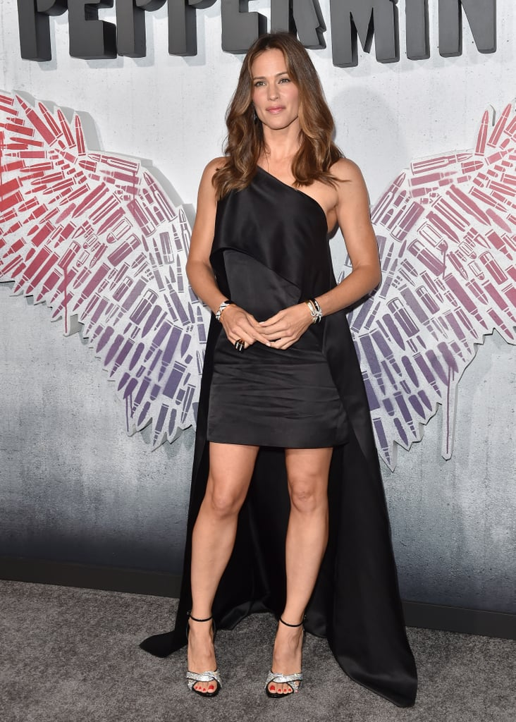 "When Jennifer Garner stepped out for the premiere of her new film Peppermint on Tuesday, you may have been fooled into thinking you'd gone back in time, as we got instant flashbacks to another time the actress stepped out in a dramatic one-shouldered black dress, at the 2016 Oscars. Looking just as radiant as she did back then, the actress playfully posed with costars Cailey Fleming and Annie Ilonzeh, along with director Pierre Morel, sporting an undeniable glow.  It's certainly been an eventful month for the actress. Along with promoting her new film, Jennifer was honored with a star on the Hollywood Walk of Fame and appeared to be in good spirits despite taking ex-husband Ben Affleck to rehab following a reported intervention.  Jennifer plays a grieving mother turned deadly vigilante in Peppermint, hitting theaters on Sept. 7. Until then, read on and join us in praying that Jen drops her beauty regimen soon.      Related:                                                                                                           Jennifer Garner Loves Playing Mom Roles Because ""Nothing Will Push You Further"""