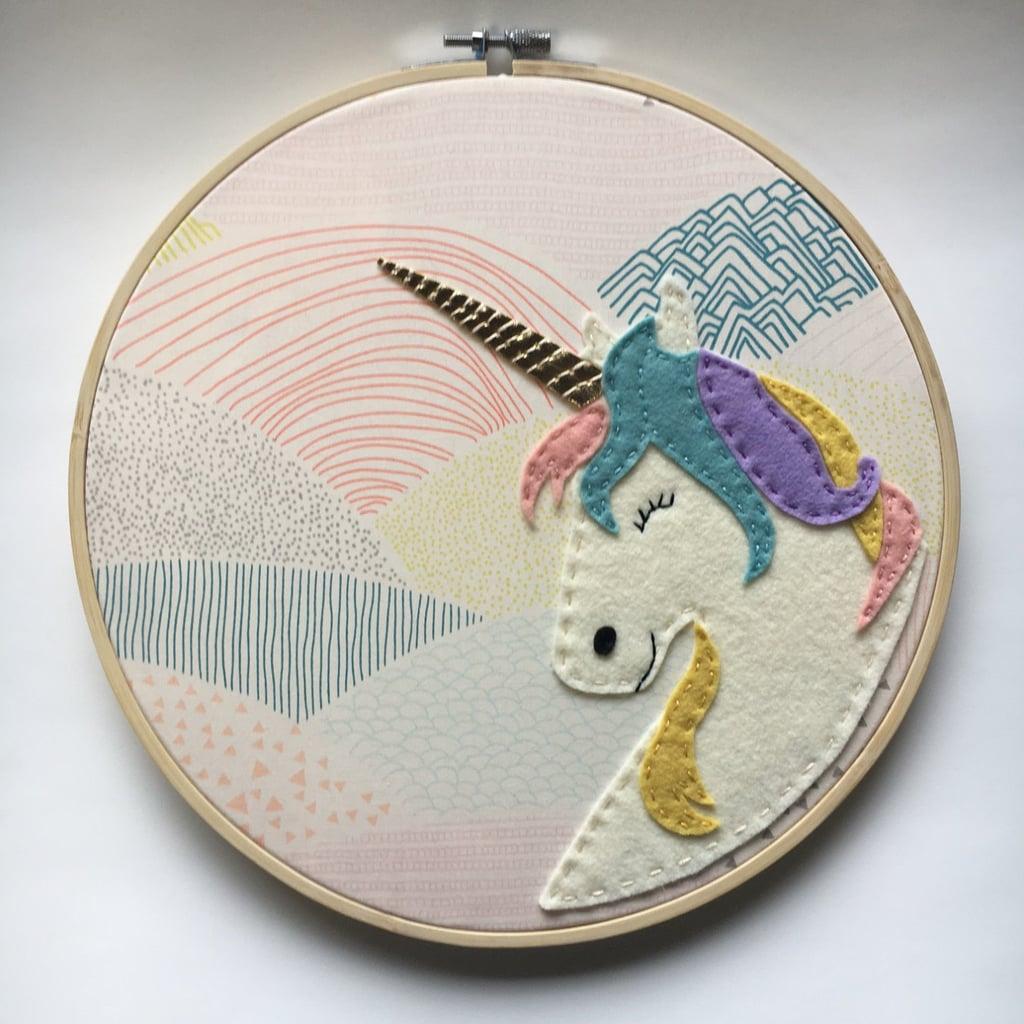 Smiling unicorn embroidery hoop