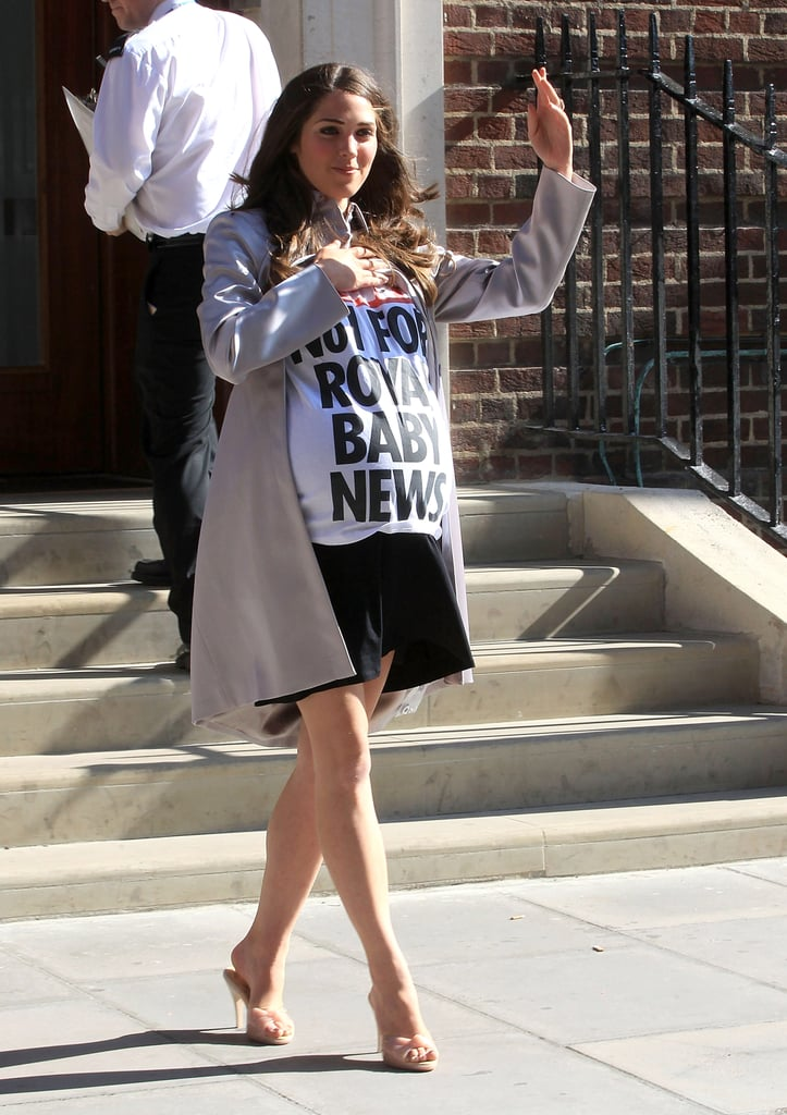 A Kate Middleton look-alike waved to photographers outside the London hospital.