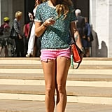 Quirky shades and a statement top upgraded this cutoff and ankle-boot combo. Source: Greg Kessler