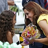 Kate Middleton received flowers from a sweet little girl during her visit to the Solomon Islands in September 2012.