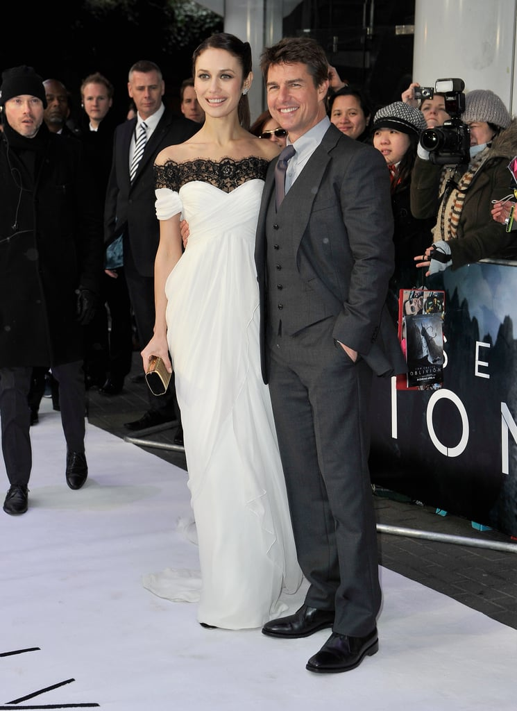 Tom Cruise and Olga Kurylenko stepped onto the white carpet in London today, as their European press tour for Oblivion continued. Tom looked dashing in a three-piece suit, while Olga was stunning in a white Marchesa, embellished with black lace, at the BFI IMAX theater. The two have certainly racked up their frequent-flyer miles over the last few days as they toured South America before heading to Moscow on Monday. They brought Oblivion to Vienna on Tuesday, then continued on to Dublin, where a deserving Tom and Olga shared a Guinness. Rounding out their trip with work, Tom premiered Oblivion in Ireland last night with Olga before jetting off again.