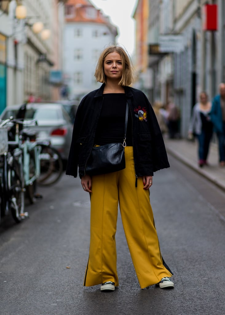 With a Black Top, a Black Jacket, and Mustard Palazzo Trousers