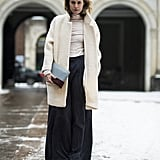 Wide-leg pants further the vintage flair of a fuzzy coat. Source: Le 21ème | Adam Katz Sinding