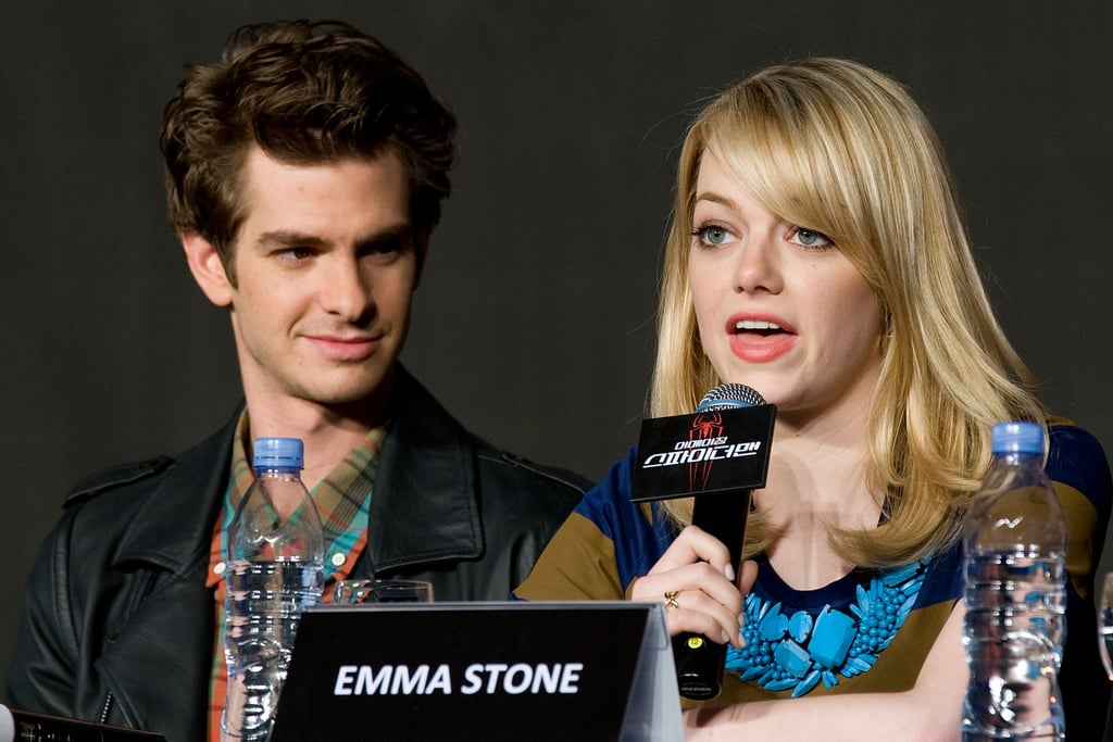 Emma Stone spoked while Andrew Garfield looked on at a press conference for The Amazing Spider-Man in Seoul.