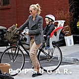 Naomi Watts had her son Kai on the back of her bike in NYC.