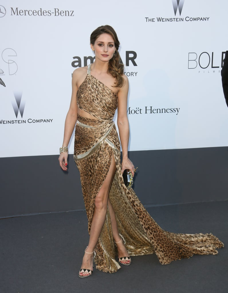 Olivia Palermo — like we've never seen her before, in a midriff-baring Roberto Cavalli slit gown — drew all eyes at amfAR's gala.