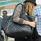 Blake's oversized quilted black tote gives her laid-back outfit a bold appeal