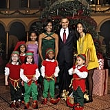The Obamas pose with the little elves.