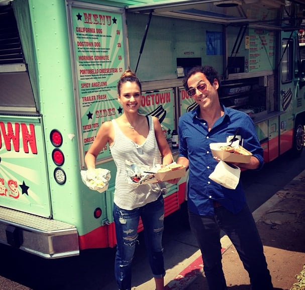 Jessica Alba snapped a photo of herself and a friend in front of a hot dog truck looking cool in distressed Paige Denim and a striped tank.   Shop it: Paige Denim James Cropped Jeans ($229) Source: Instagram user jessicaalba