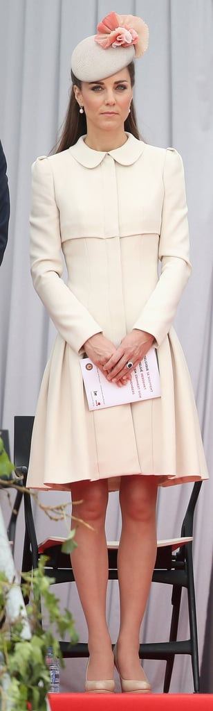 The Duchess added a floral-adorned headpiece to her Alexander McQueen look at a WWI Commemoration in 2014.