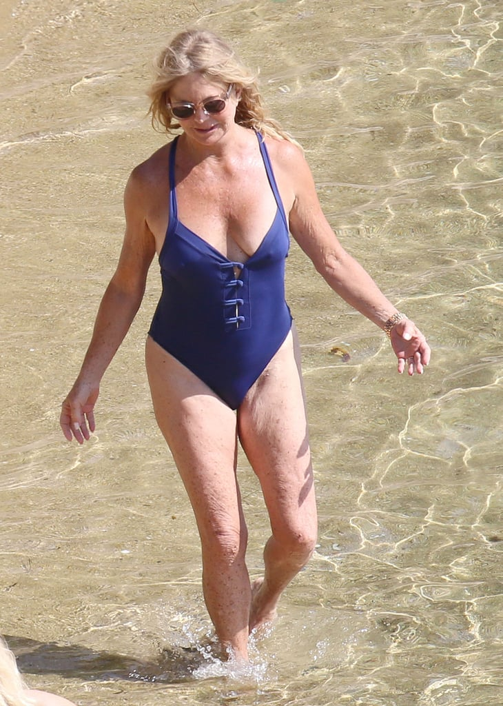 Perfect curved milf at beach
