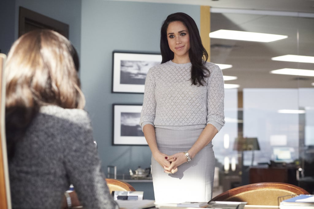 Sticking to her neutral color palette, Rachel tucked a pointelle cashmere sweater into her quintessential gray pencil skirt for a chat with her boss, Jessica Pearson.