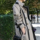 We love that this little clutch picked up on the bold piping in her trench.