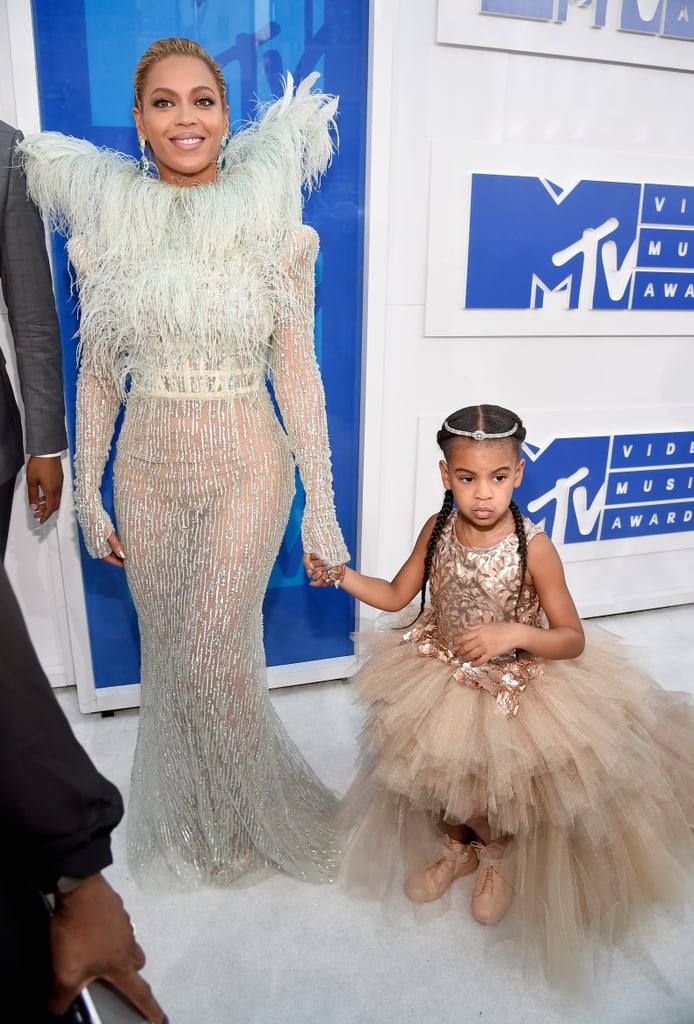 Beyoncé shook our souls when she showed up to the MTV VMAs with her 4-year-old daughter, Blue Ivy Carter, on Sunday. The singer, who is nominated for 11 awards and was rumored to be performing during the show for weeks, popped up at Madison Square Garden looking like a her usual fierce self in a Francesco Scognamiglio feathered gown covered in crystals, while Blue wore a fluffy princess dress complete with wings; the mother-daughter duo also sported matching braids and walked the carpet with a posse of Lemonade stars, including her artists Chloe and Halle Bailey, model Winnie Harlow, and the mothers of Trayvon Martin and Michael Brown. While MTV confirmed news of Beyoncé hitting the stage hours before the show — though most of us in the Beyhive had a feeling she would be gracing us with her presence — Blue Ivy's adorable guest appearance was one we didn't see coming.      Related:                                                                Look Back at Queen Bey's Incredible VMAs Moments                                                                   Beyoncé Offers an Intimate Portrait of Lemonade With Behind-the-Scenes Photos                                                                   12 Celebrities Who Are Card-Carrying Members of the Beyhive