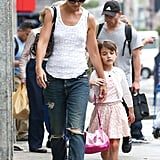 Suri Cruise held on to Katie Holmes on Friday