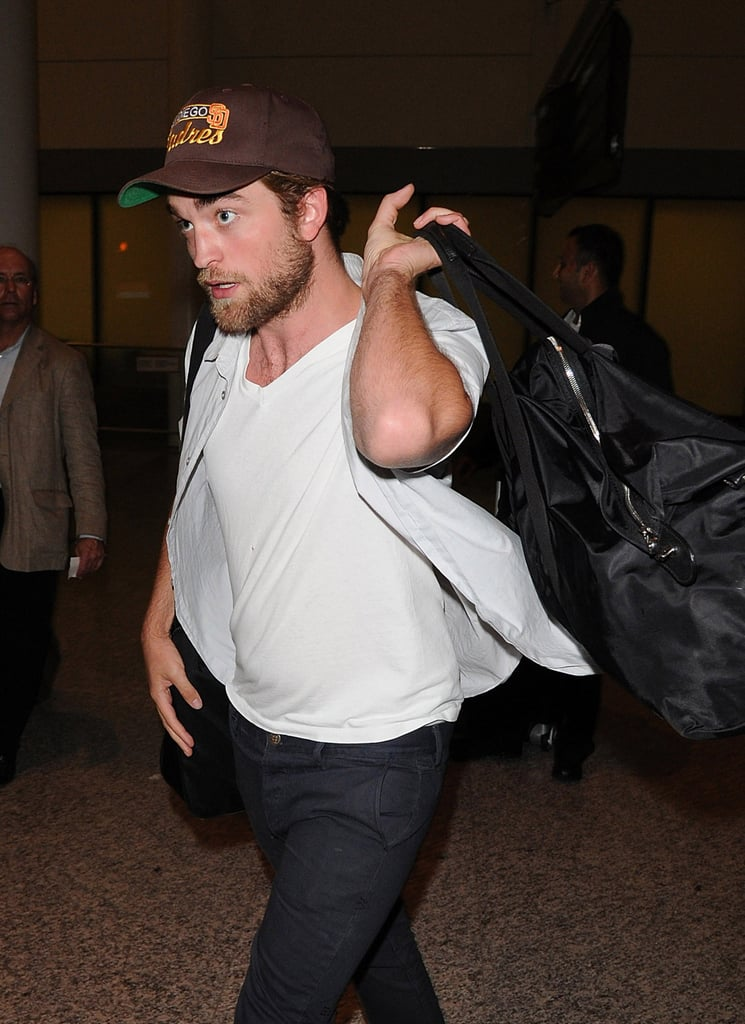 Robert Pattinson hoisted his bag over his shoulder.