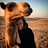 But only after she cozied up to a camel!