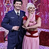 Kelly Ripa and Ryan Seacrest strike a pose as I Dream of Jeannie characters Jeannie and Major Nelson.