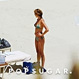 Jennifer showed off her hot figure while relaxing in the sand in Mexico in July 2003.