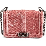 A rosy hue and velvet finish set this Rebecca Minkoff Small Love Velvet Crossbody Bag ($175) apart from the rest.